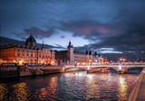 Fototapeta Paryż - Paris at Night- Bridge, Palace and Island of city © arnaud laqueyrie