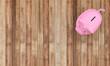 Piggy Saving Bank on Wood Background