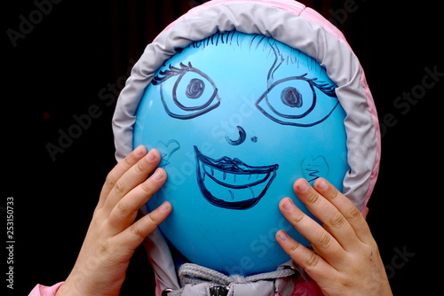 Happy balloon person close up