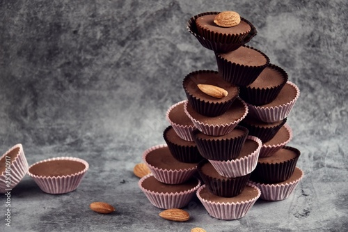 obraz lub plakat Keto Chocolate Almond Butter Fat Bombs. Paleo diet chocolate isolated on grey background