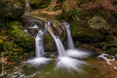The Schiessentümpel is a small and picturesque waterfall on the Black Ernz river. Mullerthal - Luxembourg's Little Switzerland. - 253162518