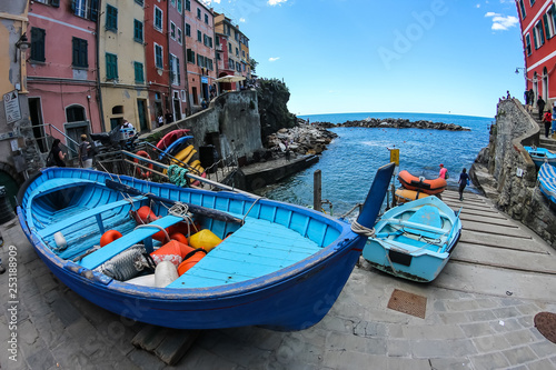 Nautical vessel in front of the harbor of Riomaggiore, Cinque Terre, Italy