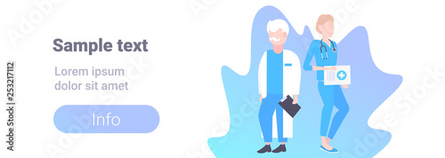 couple medical doctors team standing together two hospital workers man woman specialists in uniform male female cartoon characters full length horizontal banner copy space flat - 253217112