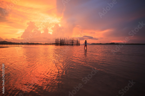 the man at sunset over lake - 253223581