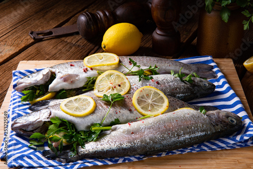 fresh trout with lemon and different herbs - 253225549