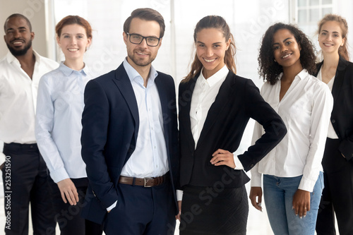 Leinwanddruck Bild Smiling diverse office workers group posing looking at camera