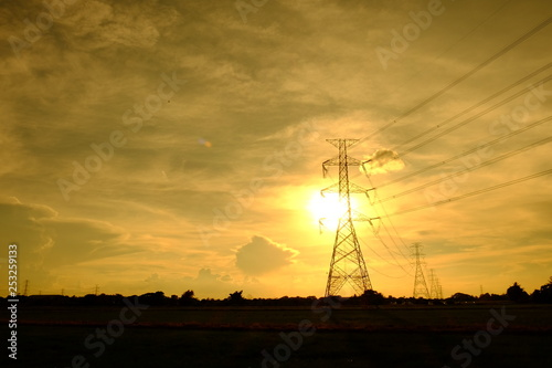 obraz PCV High voltage power poles and power transmission systems With golden yellow sky Used as a background image