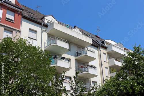 Leinwandbild Motiv nice apartment buildings with balconies