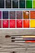 aquarelle paint box and three brushes