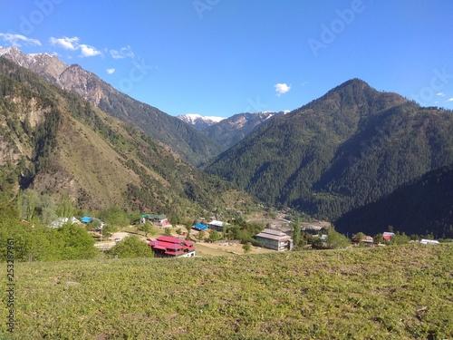 village in mountains - 253287961
