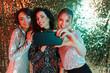 Three cheerful beautiful women wearing bright clothes