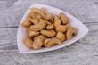 Leinwandbild Motiv Cashew nuts heap in the bowl
