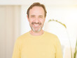 Leinwanddruck Bild - Handsome middle age man smiling looking at the camera at home