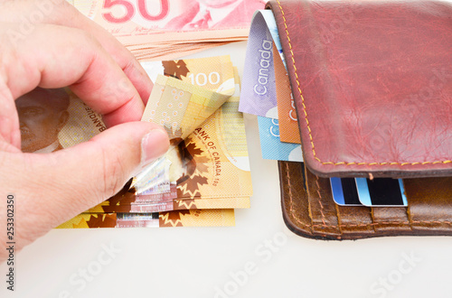 Hand counting of 100 dollars Canadian
