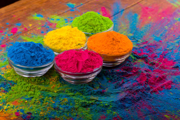 Holi color powder. Organic Gulal colours in bowl for Holi festival, Hindu tradition festive. Bright vibrant pigment closeup