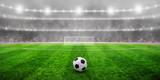 Fototapeta Sport - Ball on the green field © Alekss