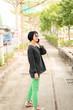 Asian woman talking on cellphone