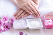 Leinwanddruck Bild - Spa treatment and product for female feet and manicure nails spa with candlelight and pink flower for relax and rest.  Healthy Concept.