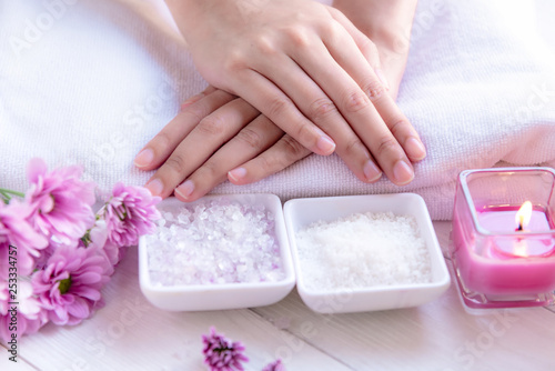 Spa treatment and product for female feet and manicure nails spa with candlelight and pink flower for relax and rest.  Healthy Concept. - 253334757