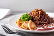 red rice with chicken and caramelized onions cranberry sauce - 253356120