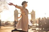 Fototapeta Londyn - Young woman walking around in the streets of London © merla