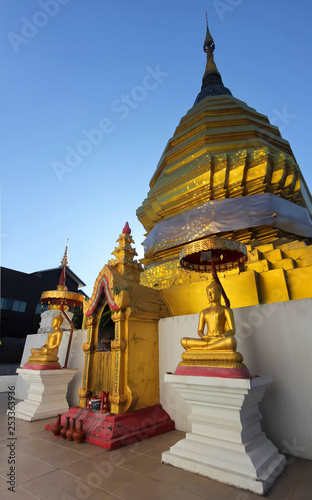 A Golden Chedi and Buddhas at Sunset, Chiang Mai, Thailand