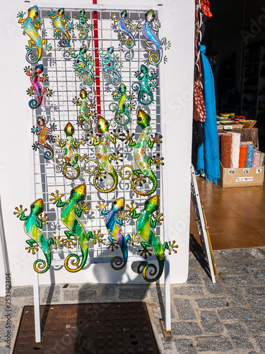 Metal Lizard wall ornaments for sale in Frigiliana one of the most beautiful white villages of the Southern Spain area of Andalucia in the Alpujarra mountains.