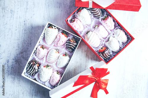 chocolate strawberries on box on desk