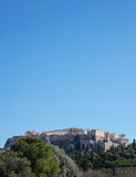 Acropolis of Athens Greece rock and Parthenon on blue sky background, sunny day.