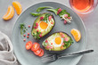 Keto diet dish: Avocado boats with ham cubes, quail eggs and cheese, top lay