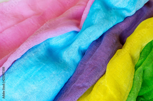 Textured background of several colored fabrics. - 253417388