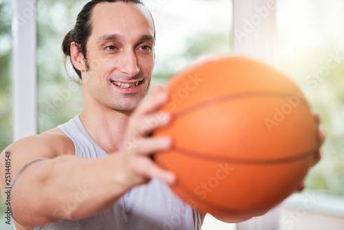 Smiling man doing balance exercise - 253448548