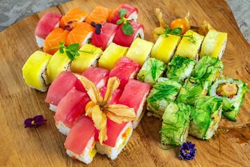 Rainbow Sushi Roll with salmon, eel, tuna, avocado, royal prawn, cream cheese Philadelphia, caviar tobica, chuka. Sushi menu. Japanese food