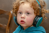little boy listening to music with headphones