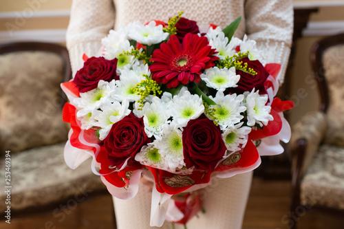 Beautiful wedding bouquet of flowers in bride's hands