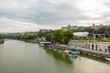 View from Bridge of piece in Tbilisi. The embankment of Kura River near the Rike Park and the President Palace above it.