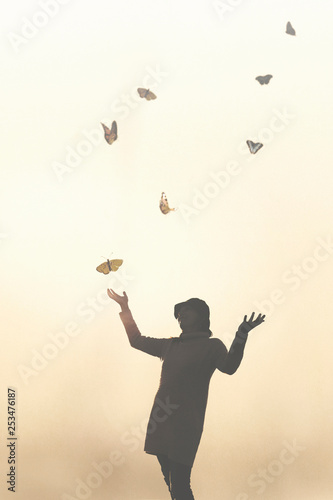 romantic scene of a meeting between a woman and colorful butterflies - 253476187
