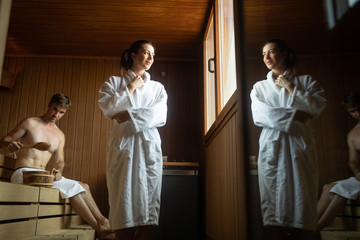 Young happy couple relaxing inside a sauna at spa resort hotel luxury © nd3000