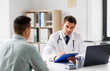 Leinwanddruck Bild - medicine, healthcare and people concept - doctor with clipboard and male patient at medical office in hospital