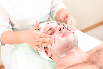 Man in the mask cosmetic procedure in spa salon  © lester120