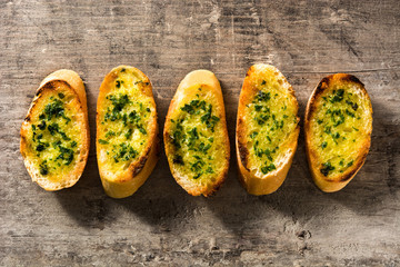 Garlic breads slice on wooden table. Top view