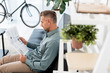 Leinwanddruck Bild - selective focus of businessman reading business newspaper in office