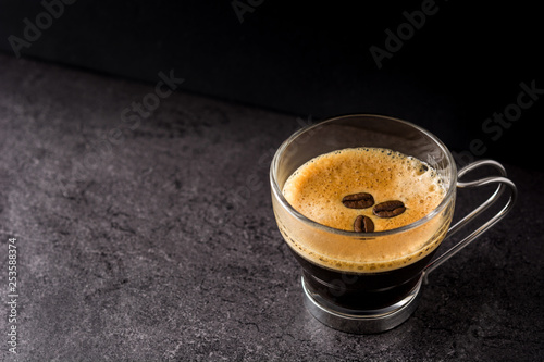 coffee glass and coffee grain on black background. Copyspace