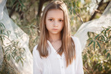 Beautiful small girl with blond hair,