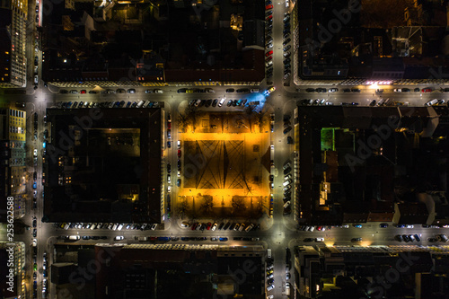 obraz lub plakat Beautiful drone shot at night of a basketball court in the middle of the city