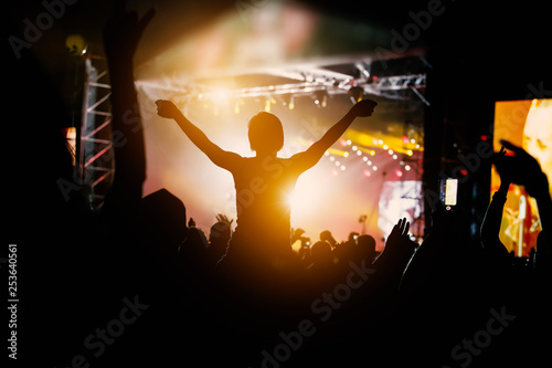 Silhouette of a happy man at the summer festival, good pastime - 253640561
