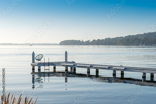 Acrylglas Pier lifestyle shot with jetty and lake