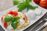 Spaghetti with fresh tomatoes, basil and mozzarella.