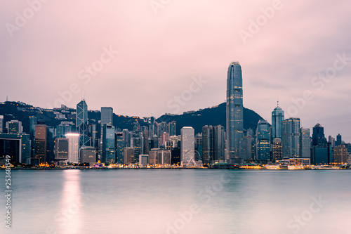 obraz PCV Hong Kong cityscape in the morning : View from Victoria Harbour with beautiful sunrise and reflection