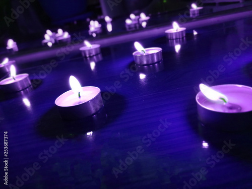Nice background with candle lights on the floor © Yulia